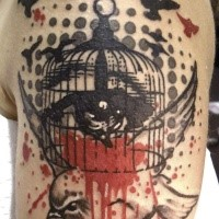 Old school style colored shoulder tattoo of small bird with cage