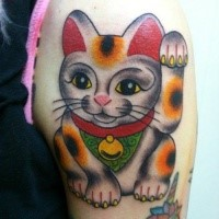 Old school style colored shoulder tattoo of maneki neko japanese lucky cat figure