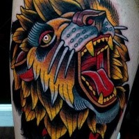 Old school style colored tattoo of lion head