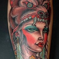 Old school style colored tattoo of tribal woman portrait with bear skin helmet