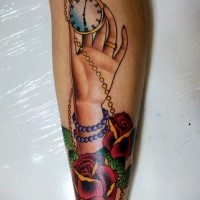 Old school style colored tattoo of woman hand with golden clock and flowers