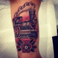 Old school style colored train tattoo on biceps with flower