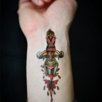 Old school style colored wrist tattoo of bloody fantasy dagger