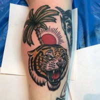 Old school style designed colored roaring tiger with palm tree tattoo on leg