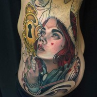 Old school style designed colorful mystical clown like woman tattoo on side combined with golden lock
