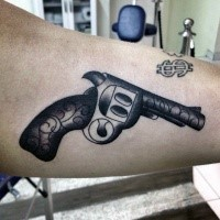 Old school style gun tattoo on biceps