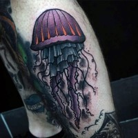 Old school style multicolored jellyfish tattoo on leg