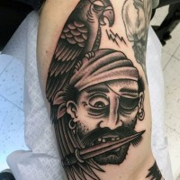 Old school style painted black and white old pirate tattoo with bird on arm