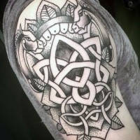 Old school style painted black and white Celtic emblem tattoo on arm