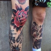 Old school style red colored knee tattoo of big rose