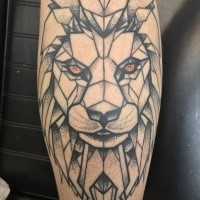 Old school style tattoo of lion face with yellow eyes