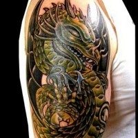 Old school very detailed looking shoulder tattoo of colored cartoon dragon