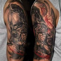 Old style black and white angry Spartan warrior tattoo on upper arm