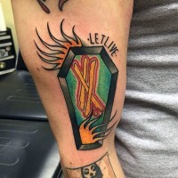 Old style colored coffin with crossed lines and fire flames arm tattoo with lettering