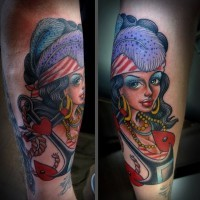 Old style painted colored seductive gypsy with anchor tattoo on arm