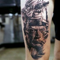 Old western themed movie hero with pistols tattoo on thigh