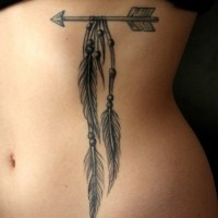 One indian arrow tattoo with feathers and beads