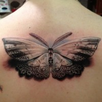 Openwork tender colored moth tattoo