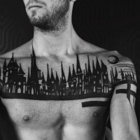 Original black ink chest tattoo of night city sights with moon