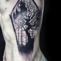 Original coffin shaped black ink side tattoo stylized with old castle and dark tree