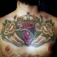 Original colored big chest tattoo of human heart with hands and crown