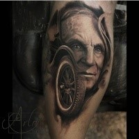 Original combined and colored man face with old car wheel