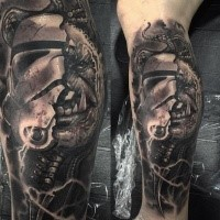 Original combined black ink arm tattoo of Storm troopers helmet with tribal man