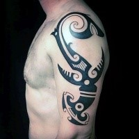 Original design dark black ink big size hammerhead shark tattoo on upper arm in tribal style
