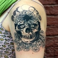 Original designed black ink upper arm tattoo of human skull with flowers