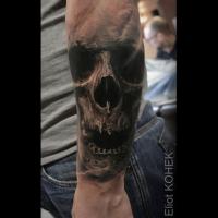 Original designed by Eliot Kohek arm tattoo of human skull with fog