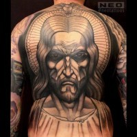 Original designed colored angry Jesus portrait tattoo on whole back area