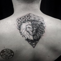 Original designed dot style separated upper back tattoo of lion head with geometrical ornaments