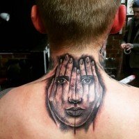 Original painted black ink hands with face tattoo on upper back