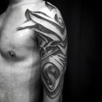 Ornamental style black ink shoulder tattoo of fantasy armor
