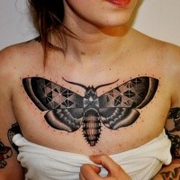 Ornamental style colored chest tattoo of butterfly with ornaments