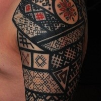 Ornamental style colored shoulder tattoo if Asian armor with ornaments