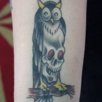 Owl with skull chest tattoo