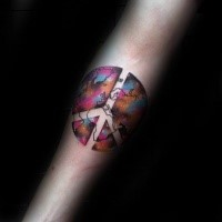 Pacific symbol shaped colored forearm tattoo stylized with world map and space