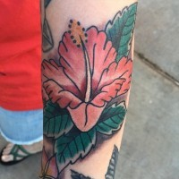 Pale red hibiscus flower tattoo on forearm in old school style
