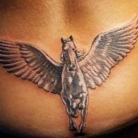 Pegasus tattoo on lower back