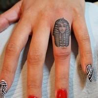 Pharaoh mask tattoo on finger