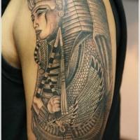 Pharaoh with power symbols tattoo on arm