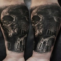 Photo like detailed by Eliot Kohek forearm tattoo of human skull with old cathedral