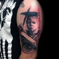 Photoshop style colored shoulder tattoo of maniac man with eye