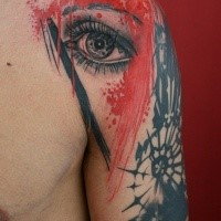 Photoshop style colored shoulder tattoo of woman eye