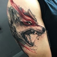 Photoshop style colored upper arm tattoo of demonic wolf