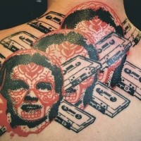 Photoshop style colored upper back tattoo of woman faces with tapes