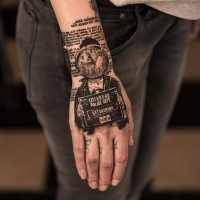 Photoshop style colored wrist tattoo of police like portrait and lettering