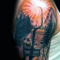 Picture style colored shoulder tattoo of man with sun and mountain
