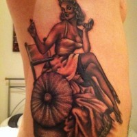 Pin up girl corrects make up tattoo on ribs